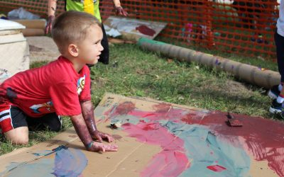 Little boy in red shirt, playing at The MILL